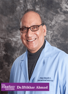 Head shot of a man in doctor coat: USA Fibroid Centers' doctor Iftikhar